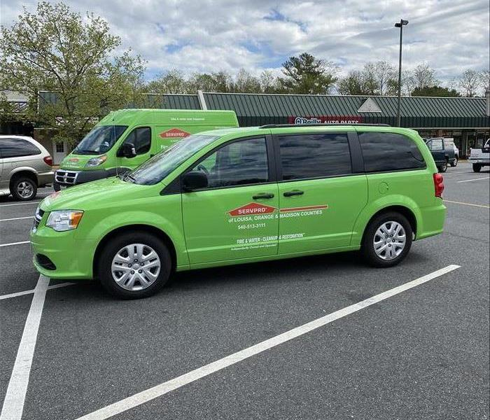 Dodge caravan painted SERVPRO green with franchise lettering