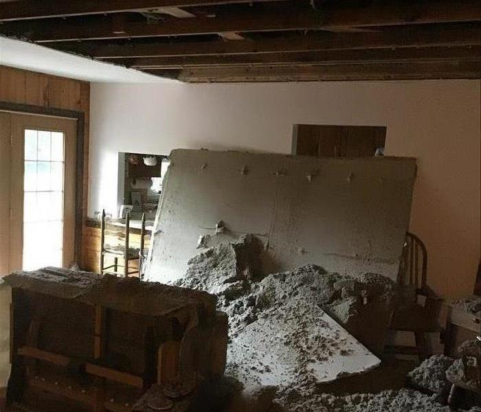 rubble after the ceiling caved in in a living room